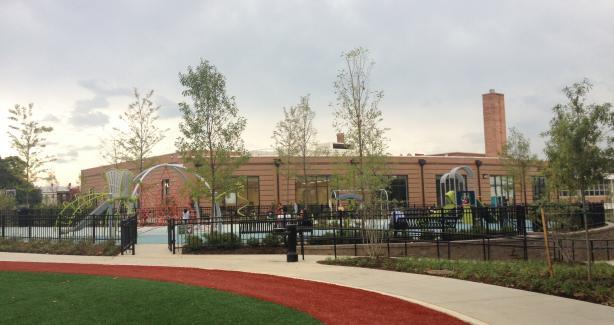 photo of new playground at Raymond Recreaiton center with landscaping surrounding play equipment.