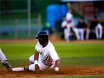 Man sliding into base on a baseball field