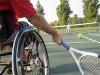 Person in wheelchair playing tennis
